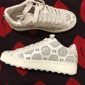 Brand new Coach leather sneakers